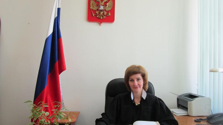 Районный судья